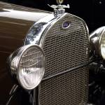 """Detail of the headlights and radiator of a old car"" by conoce3000"