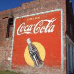 """Route 66 - Coca Cola Ghost Mural"" by Ffooter"