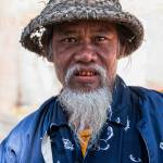 """Elderly Burmese Man"" by mjphoto-graphics"