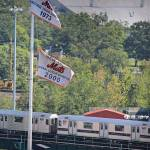 """The 7 train / Mets banners"" by DarrenMeenan"