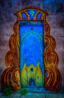 Colourful doorway art, adobe house