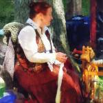 """Woman Spinning Yarn at Flea Market"" by susansartgallery"