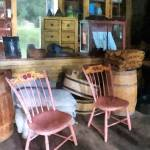 """Two Pink Chairs in General Store"" by susansartgallery"