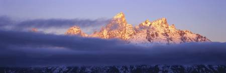 Snowcapped mountains at dawn