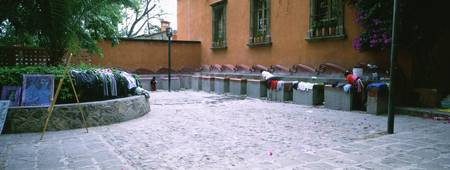 Woman washing clothes at a public washbasin