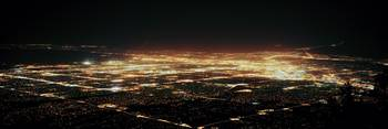 Aerial view of buildings at night in a city Albuq