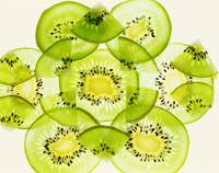 Pieces of kiwi fruit forming a pattern