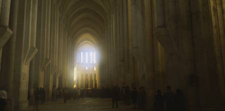 Group of people in the hallway of a cathedral