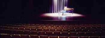 Grand piano on a concert hall stage