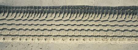 High angle view of a tire track on the sand