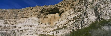 Low angle view of cliff dwellings
