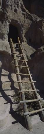 Ladder leading into an opening of a cliff dwellin