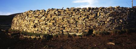 Stone wall in a field Saunders Island Falkland Is