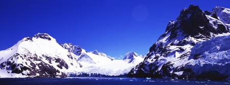 Snow covered mountains Penguin Island Antarctic P