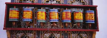 Low angle view of prayer wheels spinning