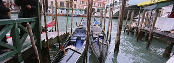 Gondolas moored near a bridge