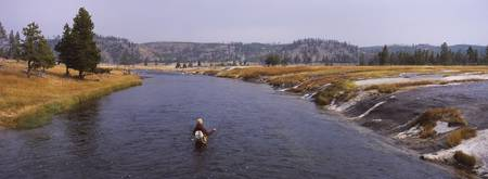 Fisherman fishing in a river