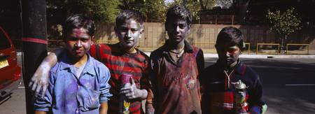 Portrait of four boys celebrating Holi festival