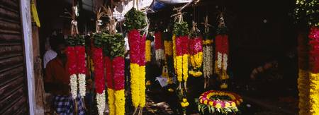 Garlands hanging at a market stall
