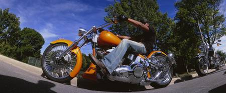 Low angle view of a man riding a motorcycle