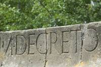 Close-up of text engraved on a wall
