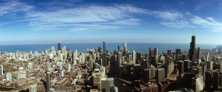 Aerial view of a cityscape with Lake Michigan in