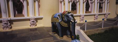 Statue of an elephant in the courtyard of a templ