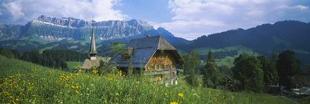 Chalet and a church on a landscape