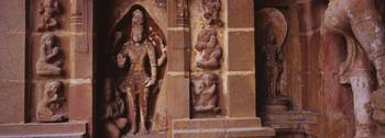 Statue of an Indian god carved on the wall of a t