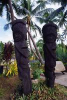 Carved Totems And Palm Trees