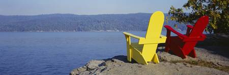 ... Red And Yellow Adirondack Chairs Near A Lake