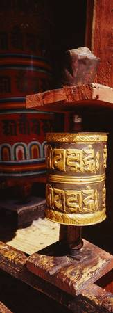 Close-up of two Buddhist prayer wheels