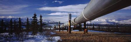 Pipeline passing through a snow covered landscape