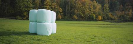 Stack Of Hay Bales Wrapped In Plastic