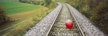 High Angle View Of A Balloon On A Railroad Track