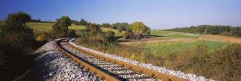 Railroad track passing through a landscape