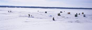 Group of people ice fishing