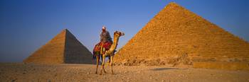 The Great Pyramids With Camel Rider Giza Egypt