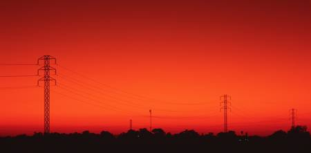 Silhouette of electricity pylons