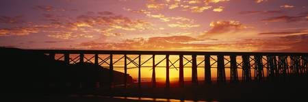 Silhouette of a railway bridge