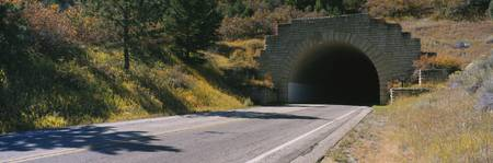 Empty road leading towards a tunnel