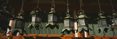 Low angle view of bronze lanterns at the Shrine
