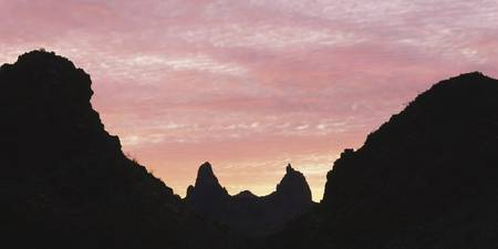 Silhouette of mountain peaks at sunrise