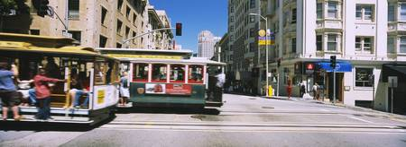 Two cable cars on a road Downtown San Francisco C