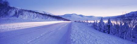 Highway running through a snow covered landscape