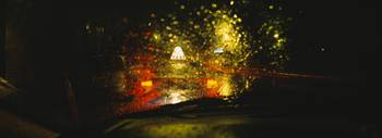 Taxi in the rain at night