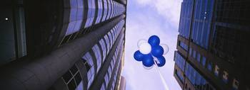Balloons floating between skyscrapers