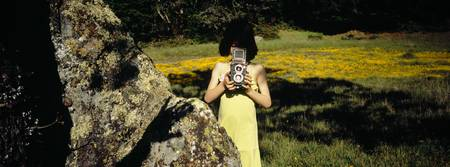 Girl taking a picture with a camera