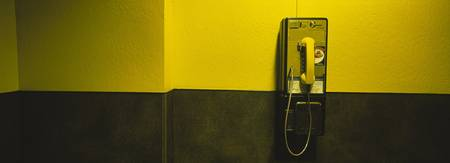 Pay phone mounted on a wall