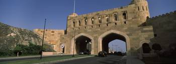 Road passing through archways Muscat Gate Museum